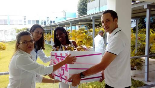 Servidores do Planserv entregam doações às OSID